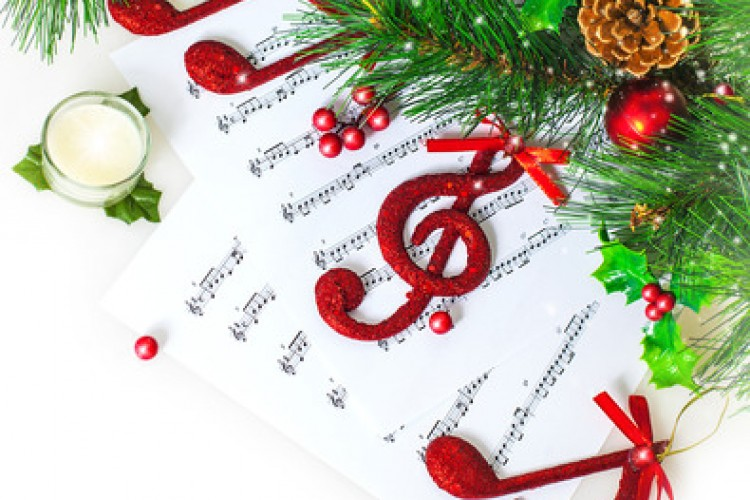 Image of red festive treble clef on the notes paper, Christmastime song, green fir tree decoration, traditional xmas carol, music sound, New Year greeting card, Christmas eve celebration